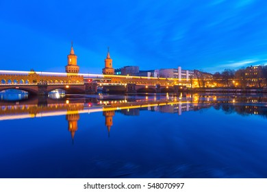 Oberbaumbruecke Berlin Winter Reflection with Night Lights and Traffic