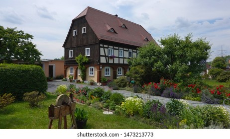 "Obercunnersdorf, Oberlausitz / Germany - June 21, 2019: Typical ""Umgebindehaus"" - an architectural style unique to the Upper Lusatia region"