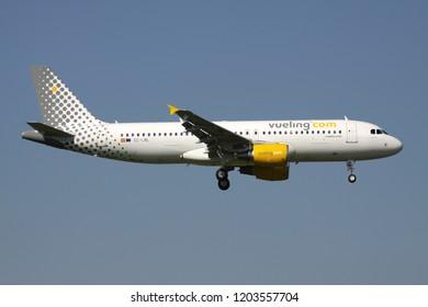 OBERGLATT, SWITZERLAND - June 27, 2011: Spanish Vueling Airbus A320-200 with registration EC-LML on short final for runway 14 of Zurich Airport.