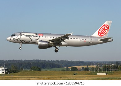 OBERGLATT, SWITZERLAND - June 27, 2011: Niki Airbus A320-200 (old livery) with registration OE-LEA on short final for runway 14 of Zurich Airport.