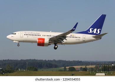 OBERGLATT, SWITZERLAND - June 27, 2011: Scandinavian Airlines SAS Boeing 737-700 with registration LN-RNU on short final for runway 14 of Zurich Airport.