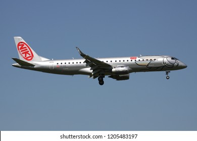 OBERGLATT, SWITZERLAND - June 27, 2011: Austrian Niki Embraer ERJ-190 (old livery) with registration OE-IHE on short final for runway 14 of Zurich Airport.