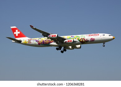 OBERGLATT, SWITZERLAND - June 27, 2011: Swiss International Air Lines Airbus A340-300 in special San Francisco livery with registration HB-JMJ on short final for runway 14 of Zurich Airport.