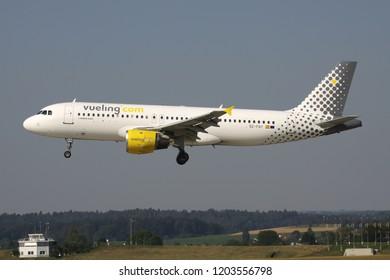 OBERGLATT, SWITZERLAND - June 28, 2011: Spanish Vueling Airbus A320-200 with registration EC-FQY on short final for runway 14 of Zurich Airport.
