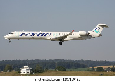 OBERGLATT, SWITZERLAND - June 28, 2011: Slovenian Adria Airways Bombardier CRJ900 with registration S5-AAO on short final for runway 14 of Zurich Airport.