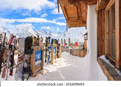 OBERGURGL SKI AREA, AUSTRIA - JAN 28, 2018: Skies in racks in mountain hut restaurant in Hochgurgl-Obergurgl ski area, Tirol, Austria.