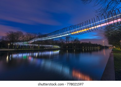 Oberhausen, NRW, Germany - February 21, 2017 : Illuminated Bridge Slinky Springs To Fame