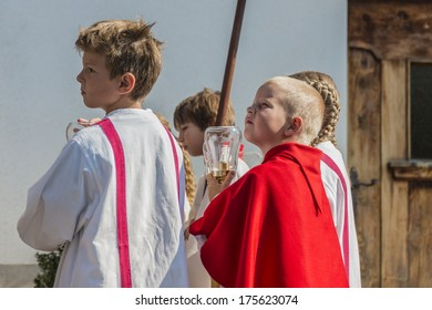 OBERPERFUSS, AUSTRIA - AUG 15: Villagers dressed in their finest traditional costumes during Maria Ascension procession along this village near Innsbruck on Aug 15, 2013 in Oberperfuss, Austria.