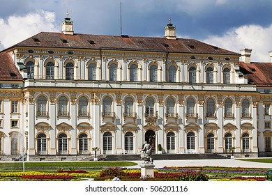 OBERSCHLEISSHEIM, GERMANY - SEPTEMBER 6, 2016  New Schleissheim palace built in early XVIII century, view of the facade in Renaissance style and the Italian garden with the statue of Hercules