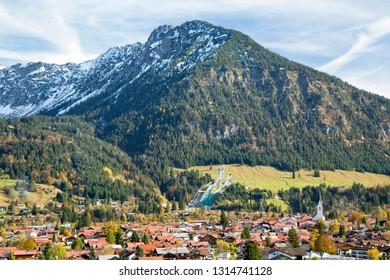 Obersdorf Alpine village in Germany, ski jump is seen in the background
