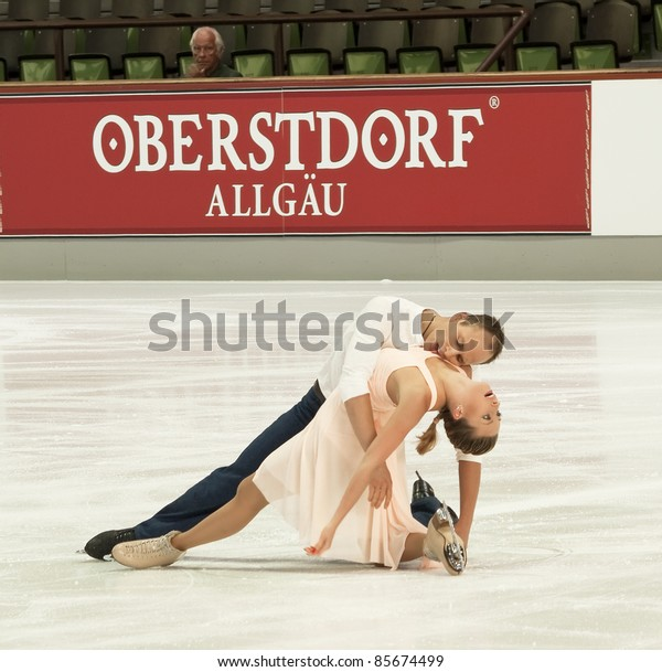 OBERSTDORF, GERMANY - SEPT 24: Figure skaters Nelli Zhiganshina and Alexander Gazsi of Germany perform their free dance at Nebelhorn Trophy on September 24, 2011 in Oberstdorf, Germany