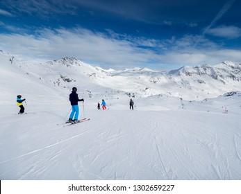 OBERTAUERN SKI RESORT, AUSTRIA - JANUARY 30, 2019: skiers in Obertauern ski area in Salzburg land, Austrian Alps.