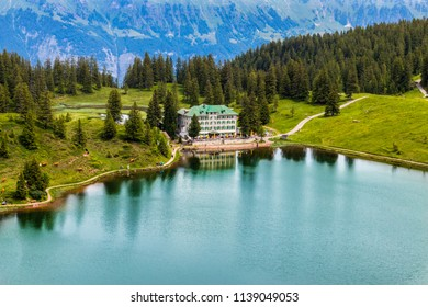 Oberterzen, Flumserberg / Switzerland - 24.6.2018: Hotel and Restaurant Seebenalp is seen in the Summer of 2018 up in the Swiss alps.