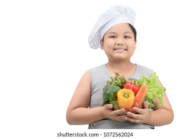 obese boy chef smaile and holding vegetables in bowl isolated on white background, healthy food concept