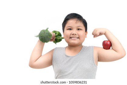 Obese fat boy holding a broccoli dumbbell and show muscle with apple isolated on white background, diet and exercise for good health concept