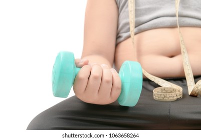Obese fat boy holding dumbbell isolated on white background, diet and exercise for good health concept