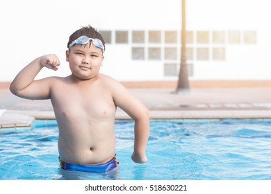 obese fat boy in swimming pool, concept healthy and exercise