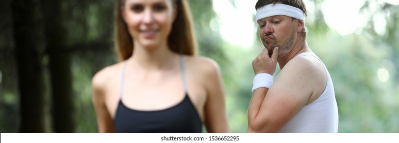 Obese man doing morning jogging in park. A girl with great figure runs by. The guy turns around look and surprisingly evaluates quality of body. Wow girls meme concept