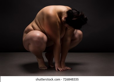 Obese nude woman doing yoga exercise. Workout  and Sumo concept.