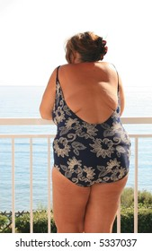 Obese woman in bathing suit