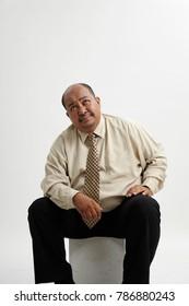 obesity businessman sitting on box