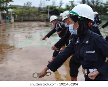 Obi Indonesia: February 25,2021, A number of security guards are doing dril exercise, handcuffs in compliance with health protocols wearing masks and helmets