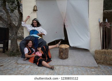 Obidos, Portugal - 23 July 2017: Medieval festival in the old walled city of Obidos - girls playing prostitutes