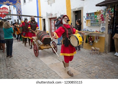 Obidos, Portugal - 23 July 2017: Medieval festival in the old walled city of Obidos - man with moustache making music