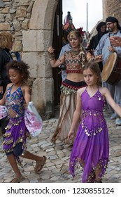 Obidos, Portugal - 23 July 2017: Medieval festival in the old walled city of Obidos - girls dancing