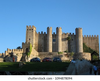 Obidos, Portugal - Circa November 2012: People attends the castle of Obidos