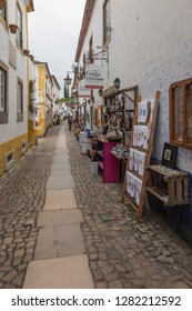 Obidos, Portugal, June 15, 2018: Street trade on the narrow street of the old town of Obidos, Portugal