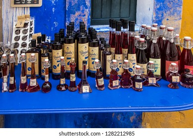 Obidos, Portugal, June 15, 2018: Sale of sour cherry from a stall in the narrow street of the old town of Obidos, Portugal