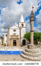 Obidos, Portugal. Medieval Town Pillory and Santa Maria Church seen from Direita Street. Obidos is a medieval town inside walls, and very popular among tourists