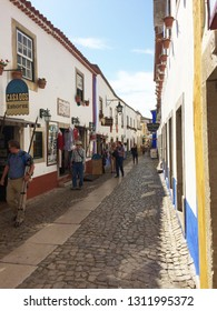 Obidos, Portugal - October 30, 2016: Street trade on the narrow street of the old town of Obidos, Portugal