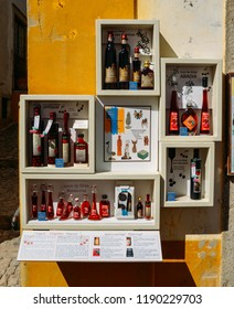 Obidos, Portugal - Sept 25, 2018: Traditional Portuguese souvenirs for sale on display captured in the historic city centre of Obidos, Portugal