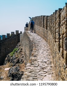 Obidos, Portugal - Sept 25, 2018: Tourists walk along the castle Ramparts at Castelo de Obidos, Leiria District, Pinhal Litoral, Portugal
