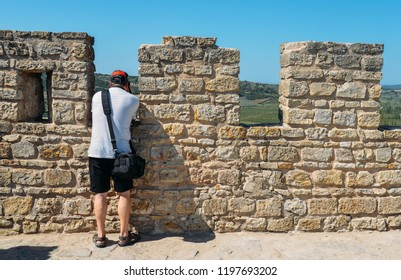 Obidos, Portugal - Sept 25, 2018: Lone unidentifiable tourist at castle Ramparts at Castelo de Obidos, Obidos, Leiria District, Pinhal Litoral, Portugal