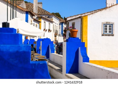 Obidos, Portugal, September 12, 2018: Blue and yellow deviding lines in town architectural design saved for generation