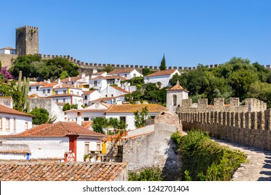Obidos, Portugal, September 12, 2018: View from the gate side to the castle over houses roofs