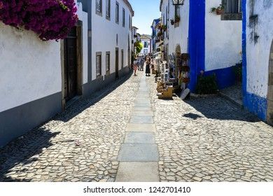 Obidos, Portugal, September 12, 2018: The main street from the gate too the castle