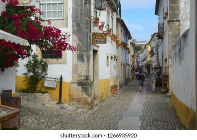 Obidos town, Portugal - October, 2016: Narrow street of Obidos old town - famous touristic destination in Portugal.