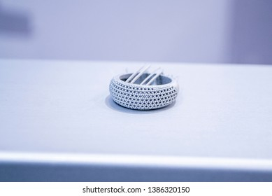 Object printed from metal powder on metal 3d printer.Object printed in laser sintering machine. Modern 3D printer printing from metal powder. Progressive additive DMLS, SLM, SLS 3d printing technology