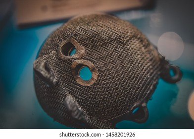 Object printed on metal 3d printer. A model created in a laser sintering machine close-up. DMLS, SLM, SLS technology. Concept of 4.0 industrial revolution. Progressive modern additive technology.
