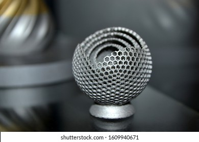 Object printed on metal 3d printer close-up. Object printed in laser sintering machine. Modern 3D printer printed from metal powder. Concept progressive additive DMLS, SLM, SLS 3d printing technology
