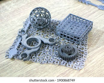 Object printed on powder 3D printer from polyamide powder close-up. Three-dimensional model from thermoplastic gray color. Rapid prototyping, printing products. Progressive modern additive technology