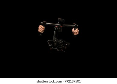 object Ronin for smooth video production make movie . isolated . camera stabilizer automatic . professional film maker with gimbal . hand held shake motor system