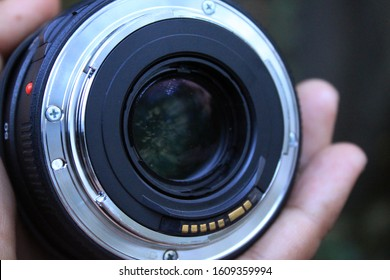 Objective lens of photo camera Canon for photo or video closeup on white background