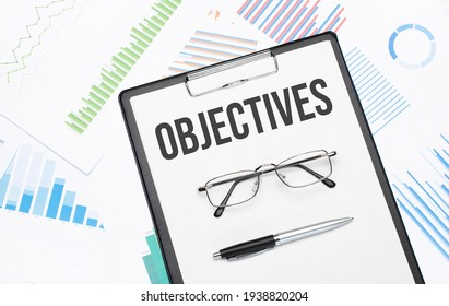 OBJECTIVES sign. Conceptual background with chart ,papers, pen and glasses