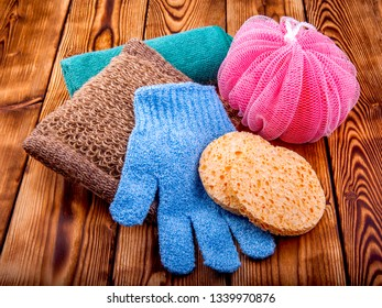 Objects for care of face skin: handmade natural soap, a sponge, the peeling brush and a massage glove