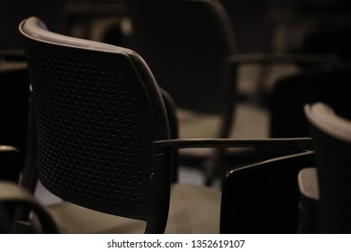 Objects. Classroom with black chairs.